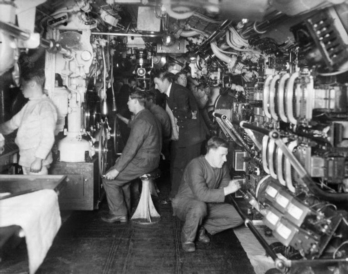 World War One: Interior of a British E-Class submarine. Officer supervising submerging operations.