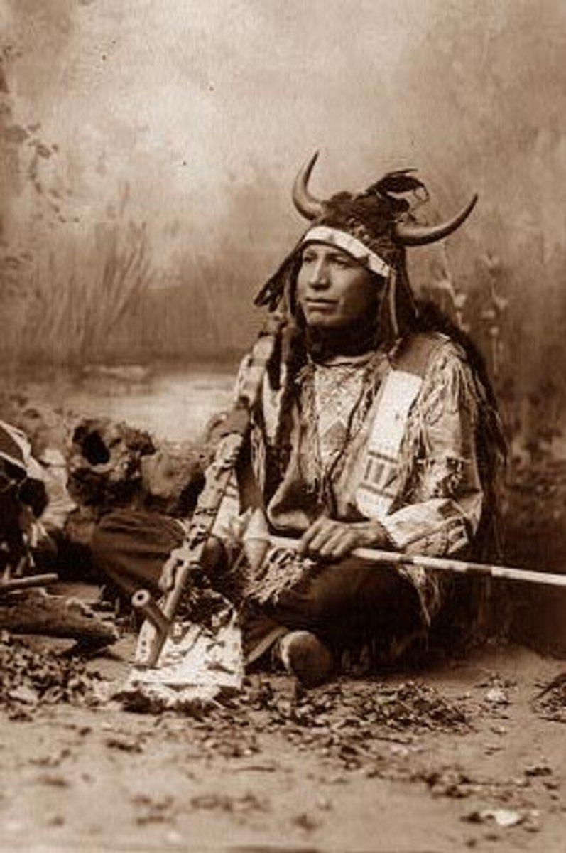Indian wearing a Buffalo Head Dress.  The photo was taken in 1899.