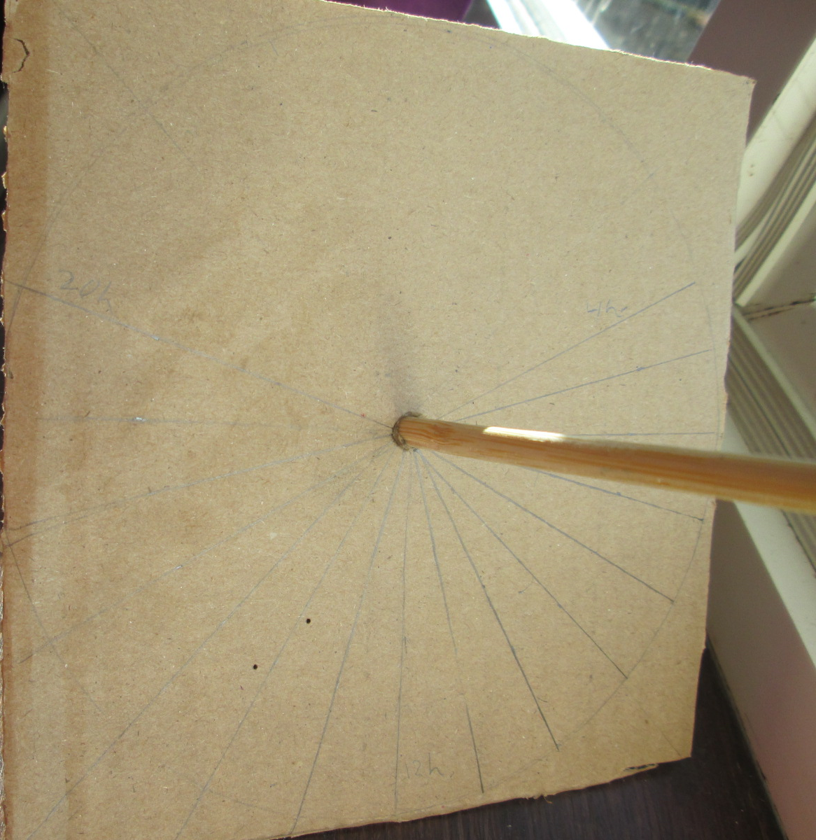 The gnomon is now stuck through the plane of the sundial.