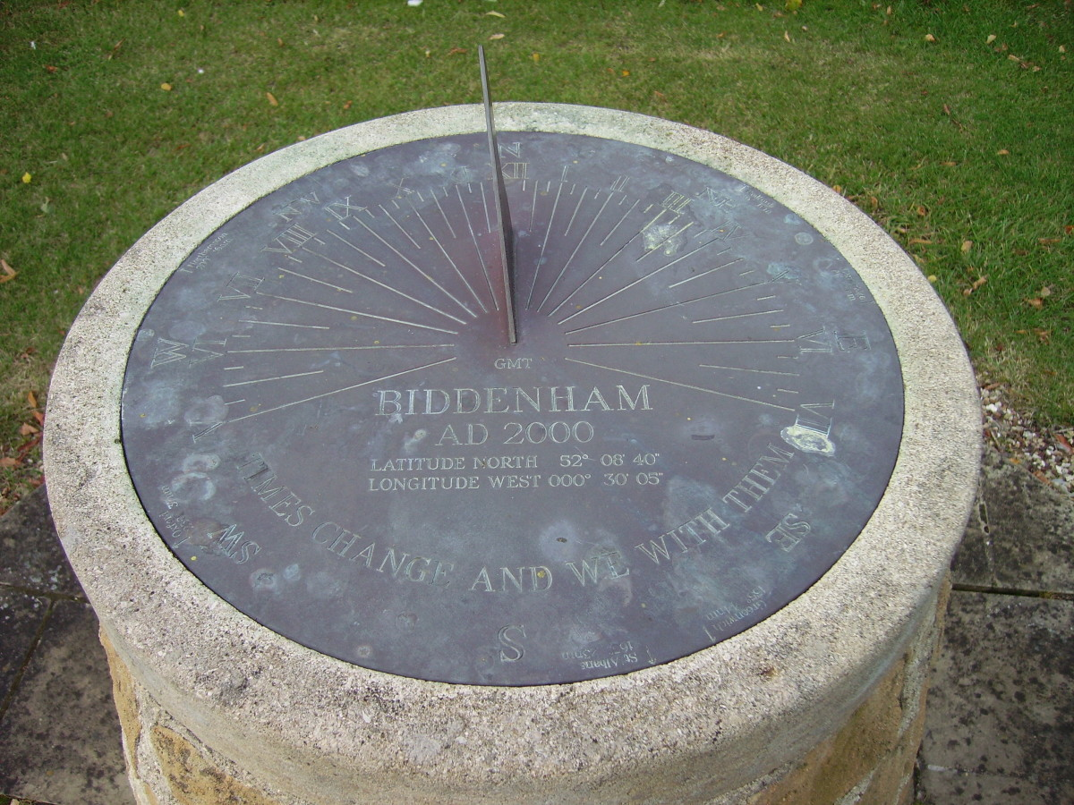 """This is a horizontal sundial sporting all the features a sundial has to offer. If you look closely at the bottom of the face, you will see the motto, """"Times change and we with them""""."""