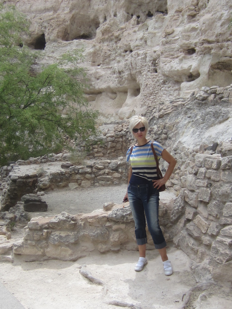 My wife standing in remains of a ground floor room of Castle A at Montezuma National Monument.