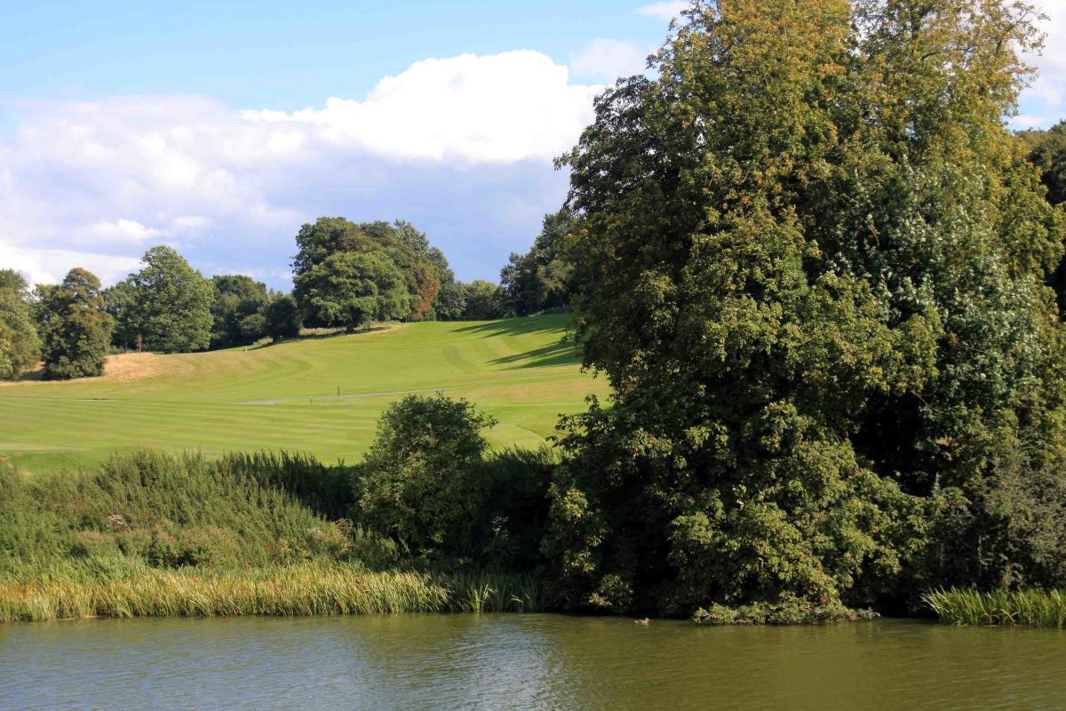 Beyond the moat is a golf course