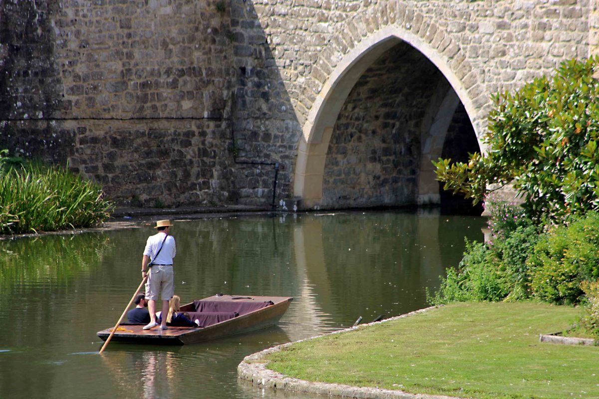 One can view the castle from the tranquility of a punt - a guide navigates the punt on a 20 minute tour around the moat