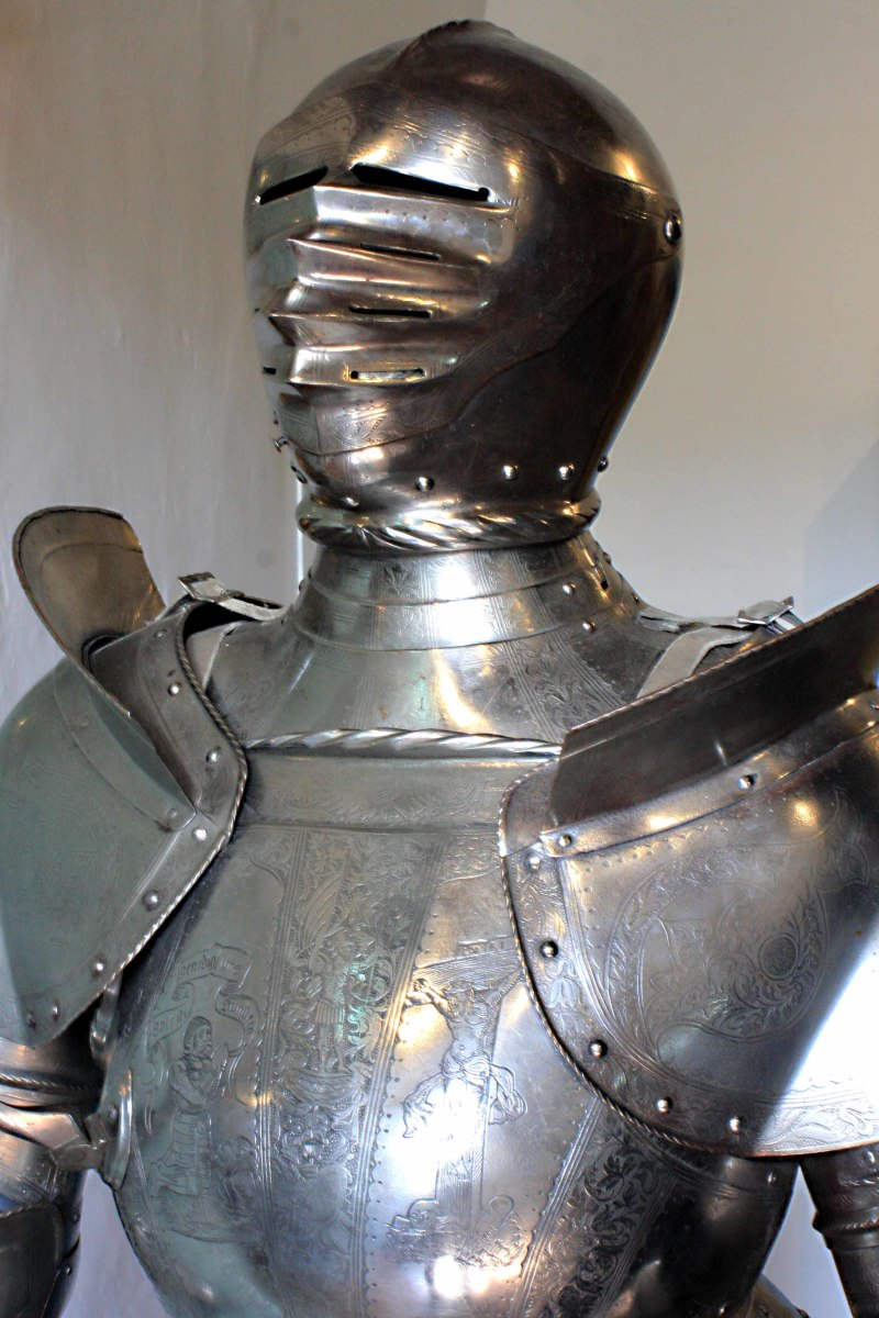 Much of this suit of armour including the breast plate is German made, but it dates from the era of Henry VIII. Other parts  are 19th century reproductions