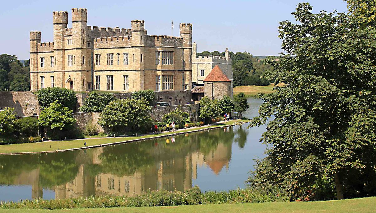 Leeds Castle from the south, featuring the New Castle. Note the pathway between the lake and the outer wall - the route for the visitor to follow into the castle rooms.