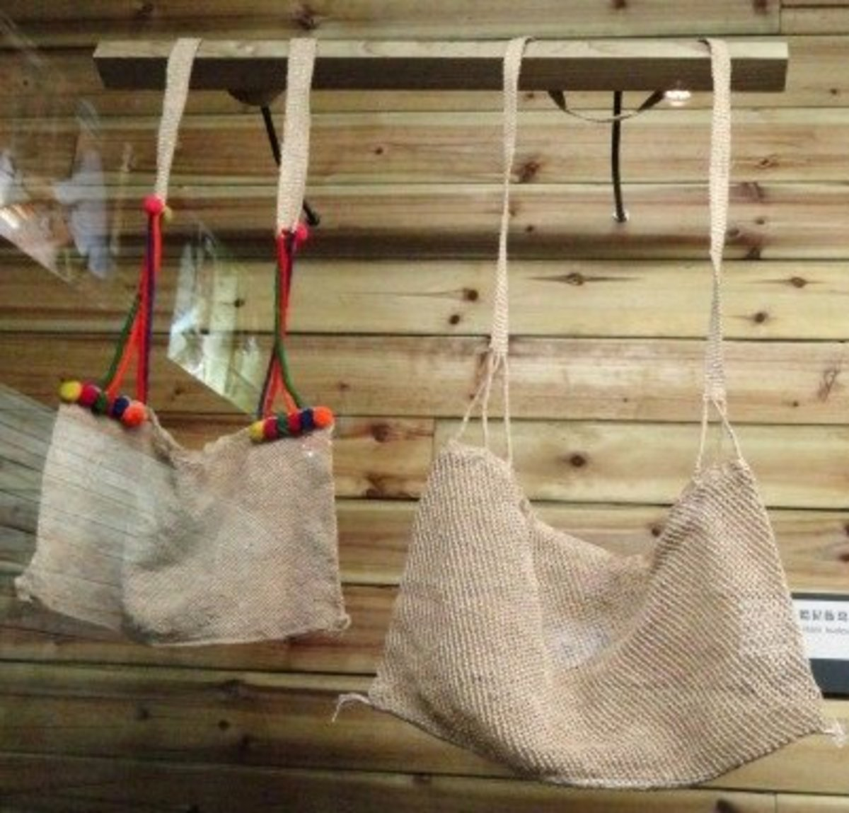 Tote bags made from woven kudzu fiber.