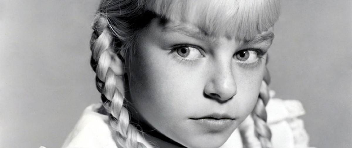 Rhoda Penmark as portrayed by Patty McCormack in the 1956 film adaptation.