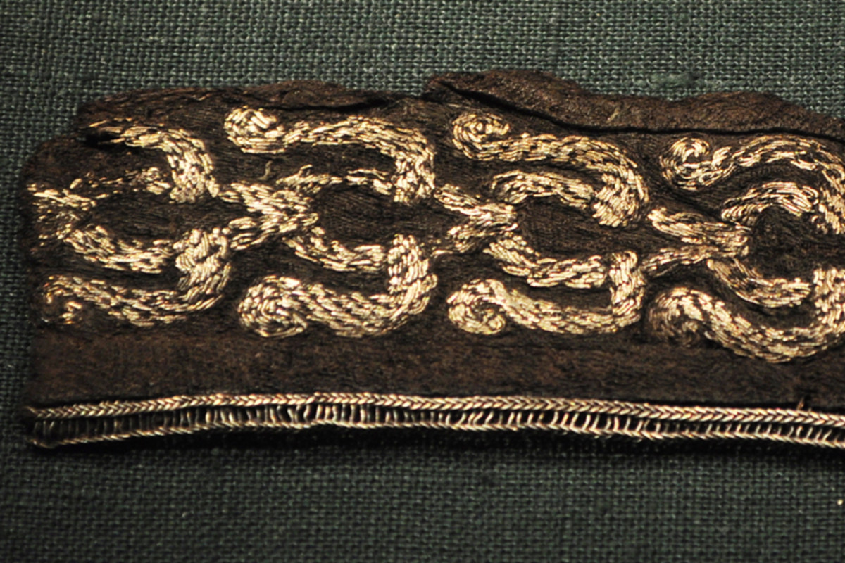 A piece of silk embroidered with silver, discovered in a Viking burial ground in Sweden. For the Vikings, Arabia was a rich source of both silk and silver.