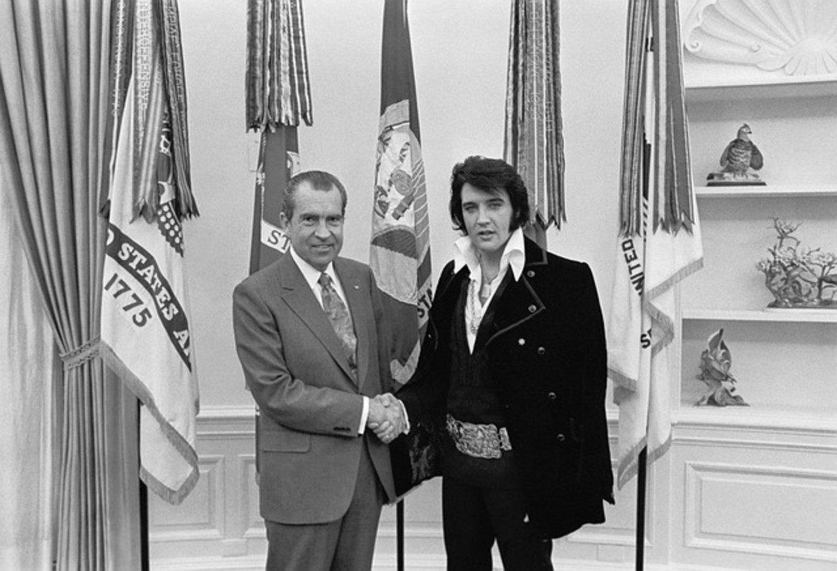Richard Nixon with Elvis Presley in 1970.  Nixon played a politically controversial role in the Vietnam War.  Elvis served in the army between 1958 and 1960. He spent most of his time in Germany, and never went to the developing Vietnam conflict.