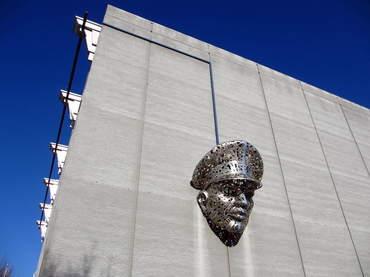 """Thin Blue Line"" by Michael Stutz. Located in Richmond Virginia in the Monroe Ward District. This piece is a 1,200 lbs stainless steel art installation to symbolize the humanity of the Police Department; however, at the same time to show sternness."