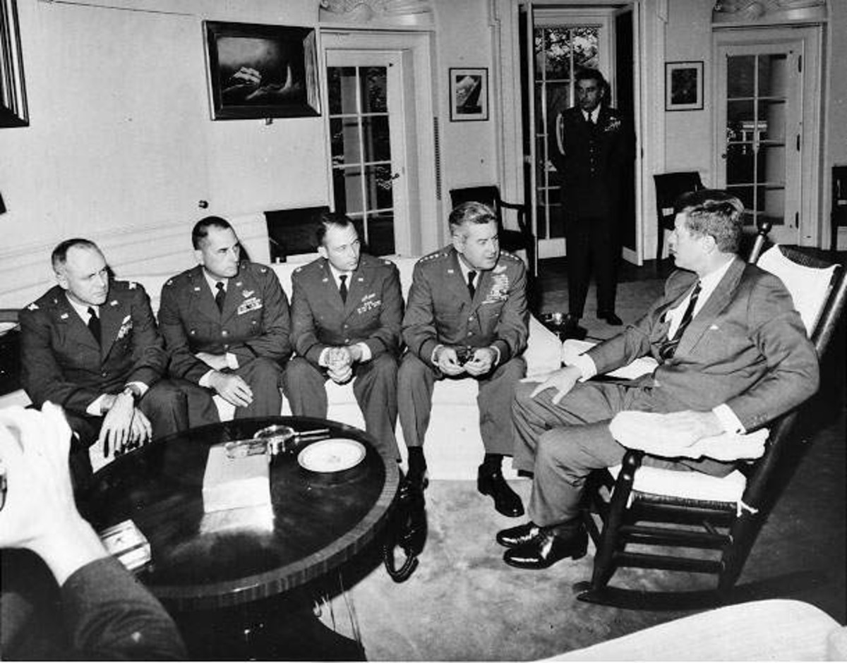 President Kennedy meets with General Curtis LeMay and reconnaissance pilots in the Oval Office. This is not the meeting described in the text, but a later meeting during the Cuban Missile Crisis (October 1962).