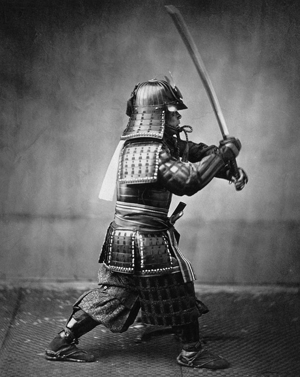 Photo of a Samurai with a sword, taken around 1860.  The Samurai were the warrior class in the Japanese social system and beneath the large land owners in the social hierarchy.