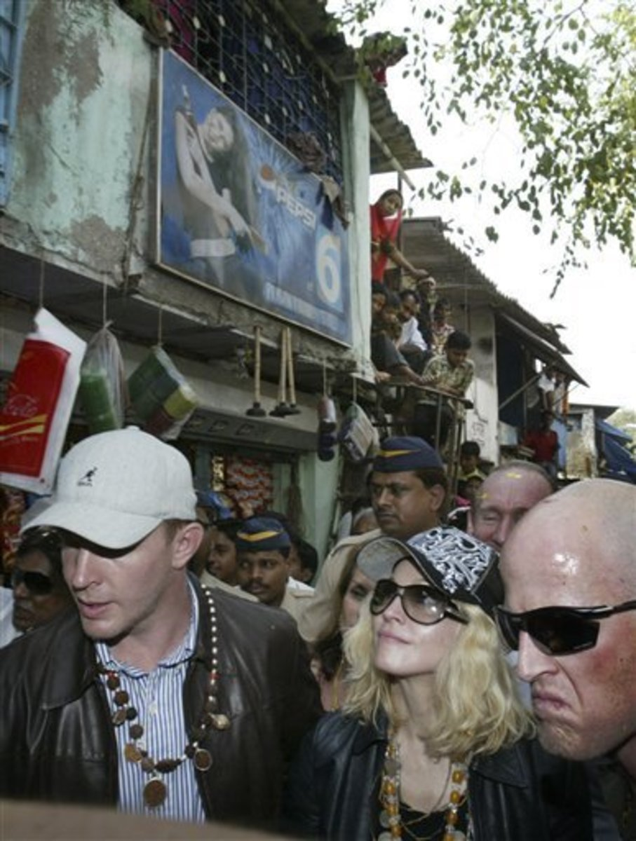 Madonna with her beau (left) and Shantaram author Roberts (right) in the Mumbai slums.