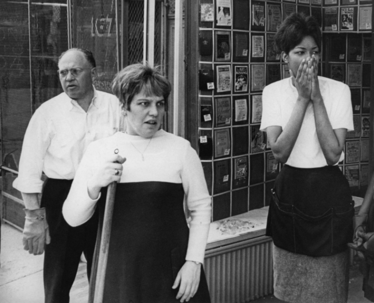 Abram Schwab (left), Beverly Schwab and Michelle Johnson gasped in disbelief as National Guardsmen with armored tanks rolled past their store on historic Beale Street on March 29, 1968.