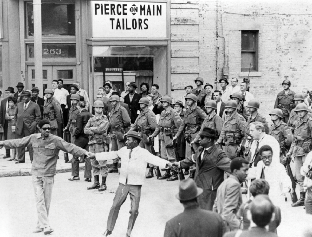 "The strike demonstrators of Memphis display a ""line of solidarity"" during the 1968 sanitations workers protests."