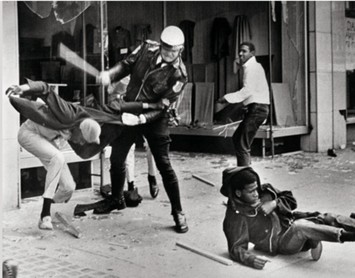 A police officer uses his nightstick on a youth reportedly involved in the looting that followed the breakup of a march led by Dr. King on March 28, in Memphis.  Later in the day, Larry Payne, the 16-year-old in the background, was killed by police.