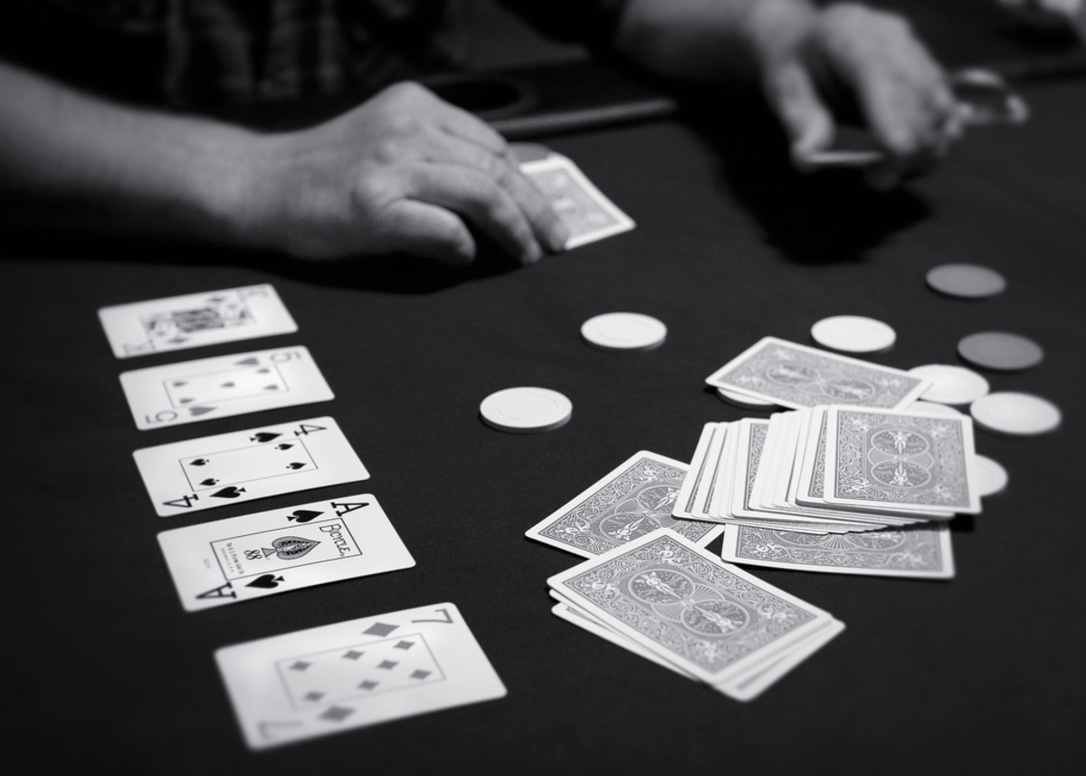 An image of a person playing the poker variant Texas Hold'em (CC-BY).