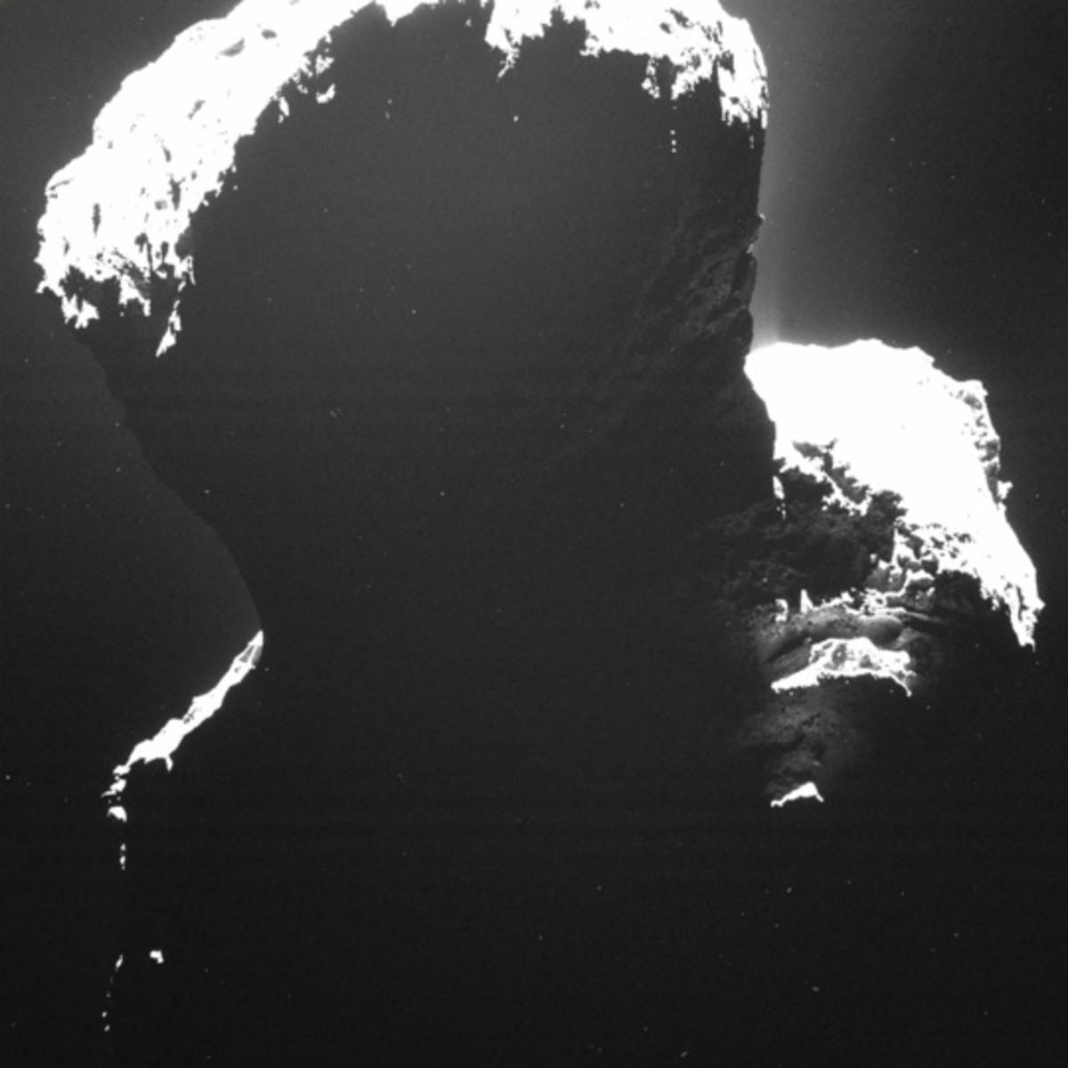 67P backlit, revealing its dark side.