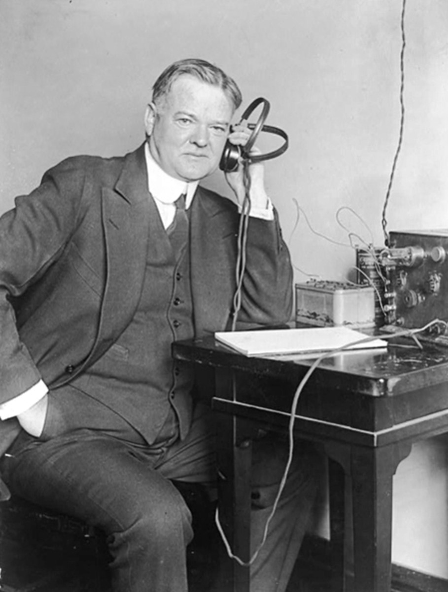 Herbert Clark Hoover listening to a radio