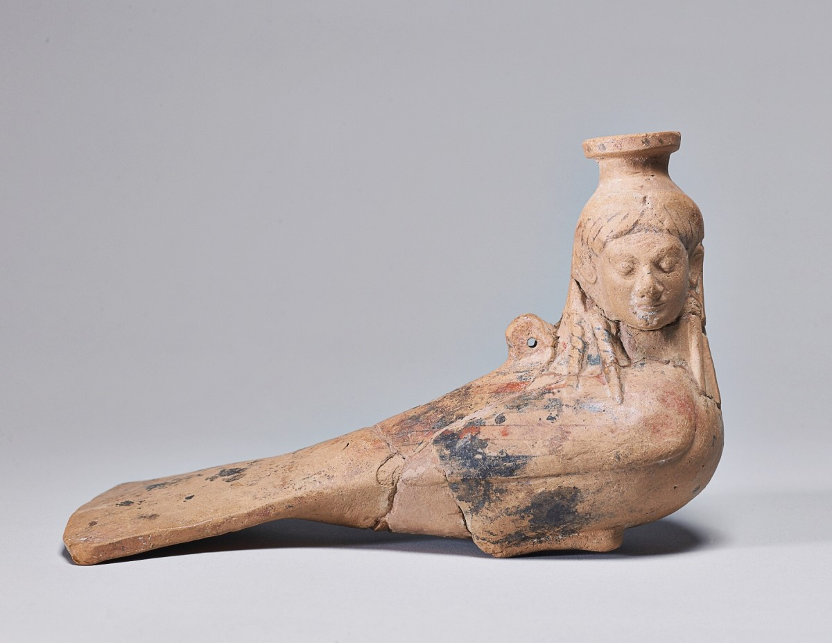 A perfume vase in the form of a Siren, circa 540 BC