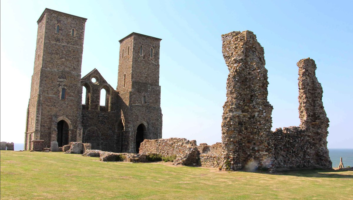 The ruins of the 7th-8th century Reculver Church, its 12th century twin towers (left) and 13th century chancel (right) lie within the grassy field which is the site of the ancient Roman fort. Originally, the towers were topped with wooden spires