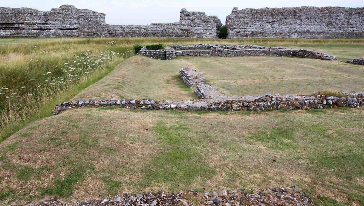 The foundations of town buildings dating from 100 AD - 250 AD. These are believed to be houses and shops. On the left is one of the 3rd century trenches constructed as Rutupiae returned to its fortress status