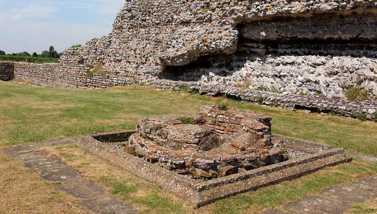 In the back ground of this photo is part of the Roman wall, but in the foreground is a baptismal font, a rare example of Christian Roman belief, and the last known Roman building on the site dating to the 4th century AD