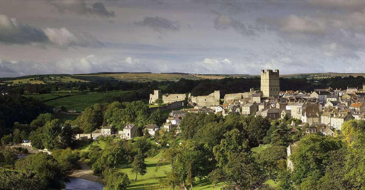 Richmond Castle and town in its setting at the crown of the hill, overlooking the Swale and backed by the Dales scenery