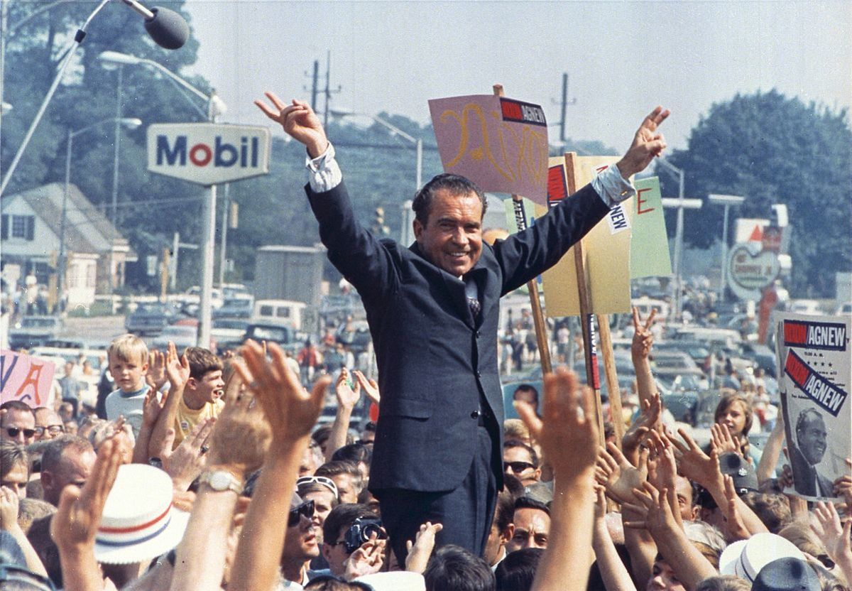 "Richard Nixon gives his trademark ""victory"" sign while in Paoli, PA (Western Philadelphia Suburbs/Mainline) during his successful campaign to become President of the United States. 1968."