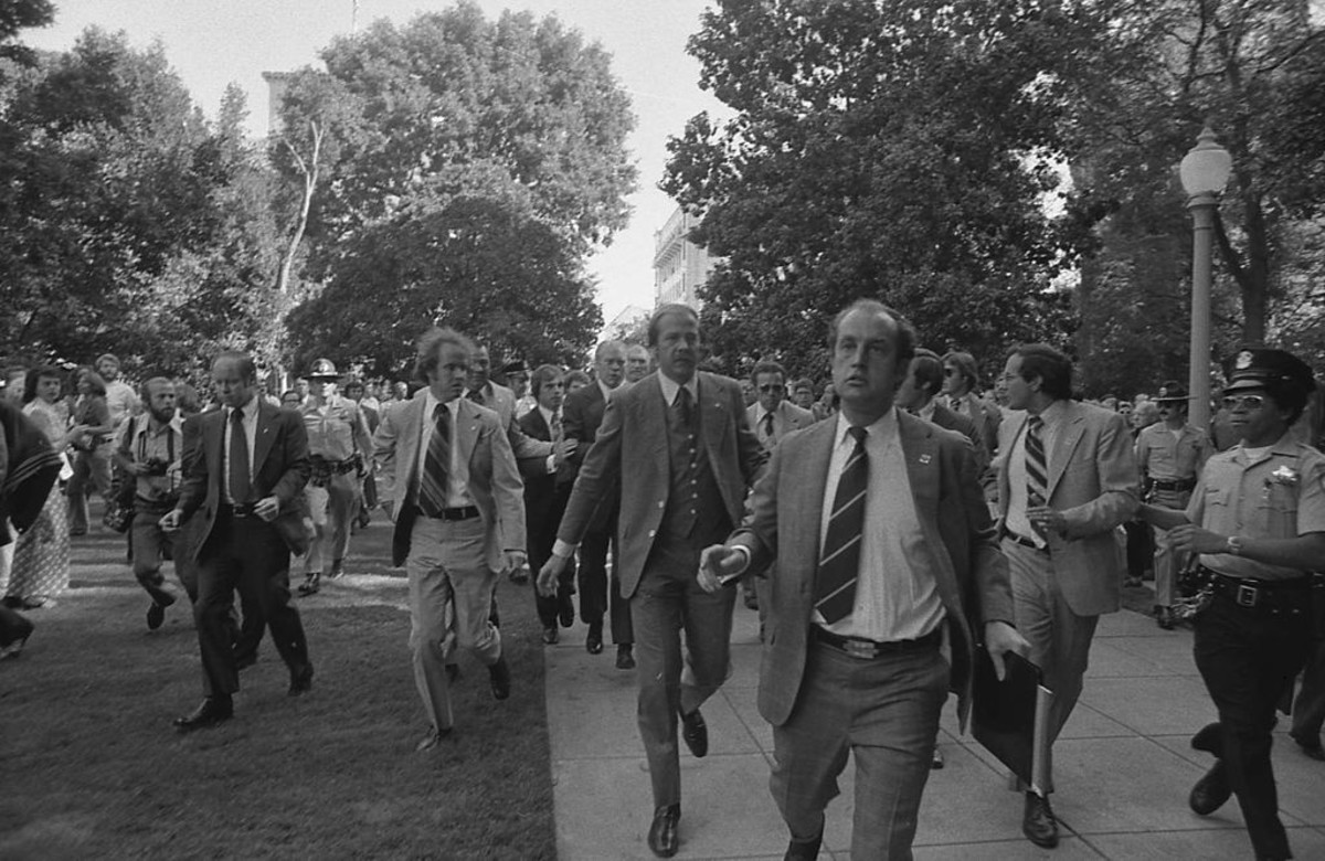 "Following the September 5, 1975 attempt on U.S. President Ford's life by cultist Charles Manson Family member Lynette ""Squeaky"" Fromme, Secret Service agents rush President Ford towards the California State Capitol in Sacramento."