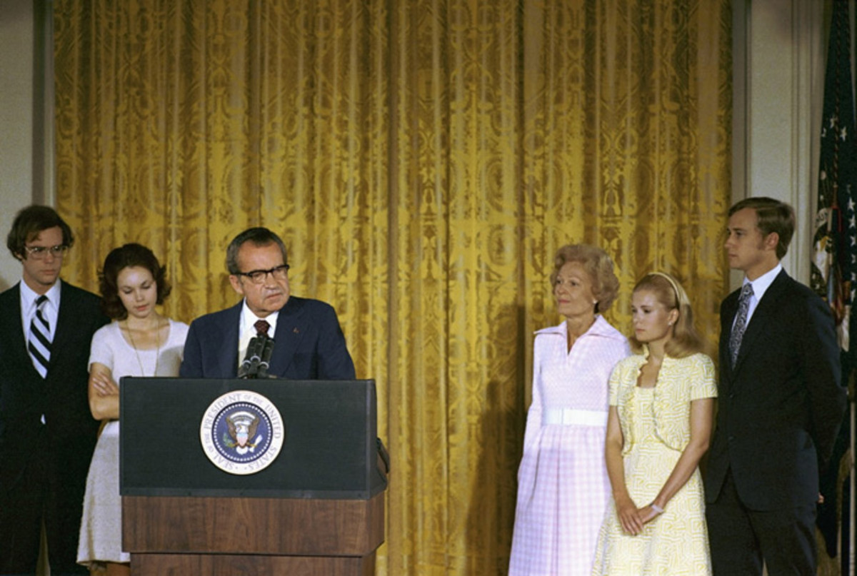 President Richard Nixon delivers remarks to the White House staff on his final day in office. From left to right are David Eisenhower, Julie Nixon Eisenhower, the president, First Lady Pat Nixon, Tricia Nixon Cox, and Ed Cox.