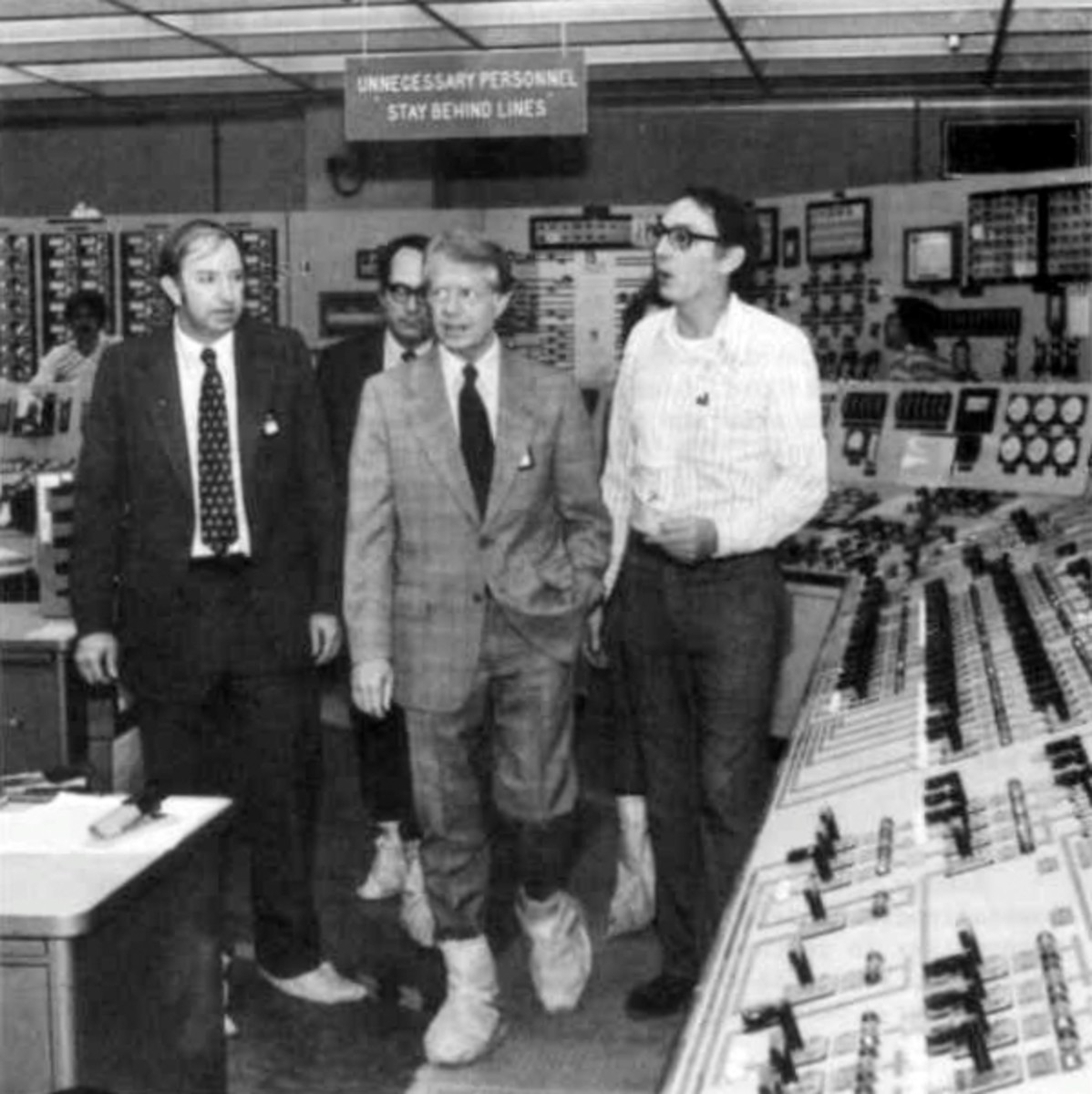 President Jimmy Carter touring the TMI-2 control room with (l to r) Harold Denton, Governor Dick Thornburgh, and James Floyd, supervisor of TMI-2 operations, on April 1.