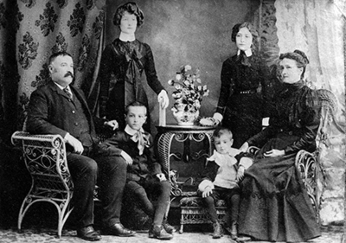 Will James's French-Canadian family. Will James is pictured sitting at his father's knee
