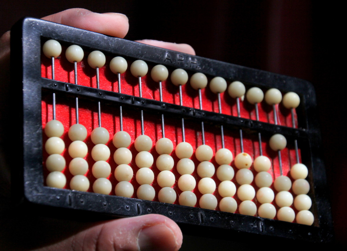 "This abacus shows the number ""10"": one bead in the tens column"