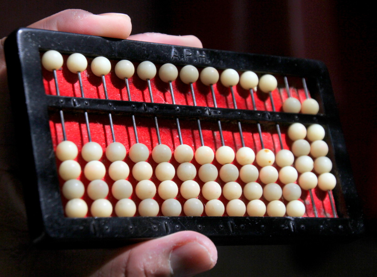 "This abacus shows the number ""99""."