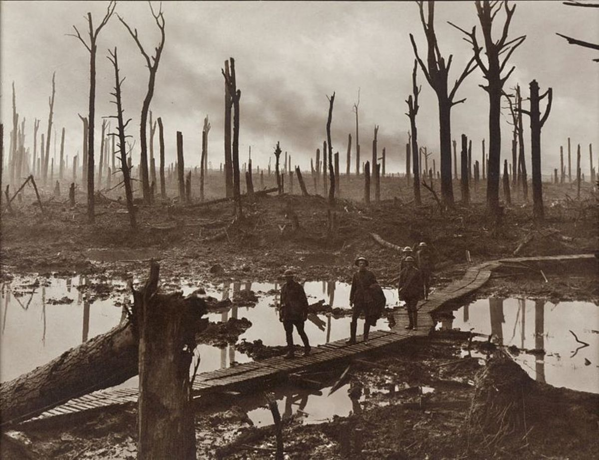 Australian soldiers walking on a duckboard track in the Ypres salient during October 1917.