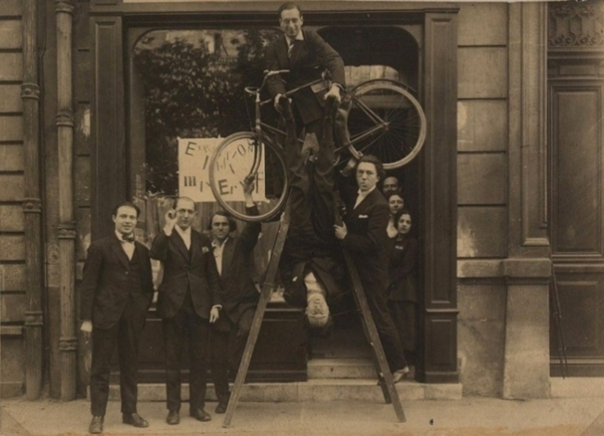 A group of Max Ernst's pals ham it up at an exhibition of his work in Paris in 1921.