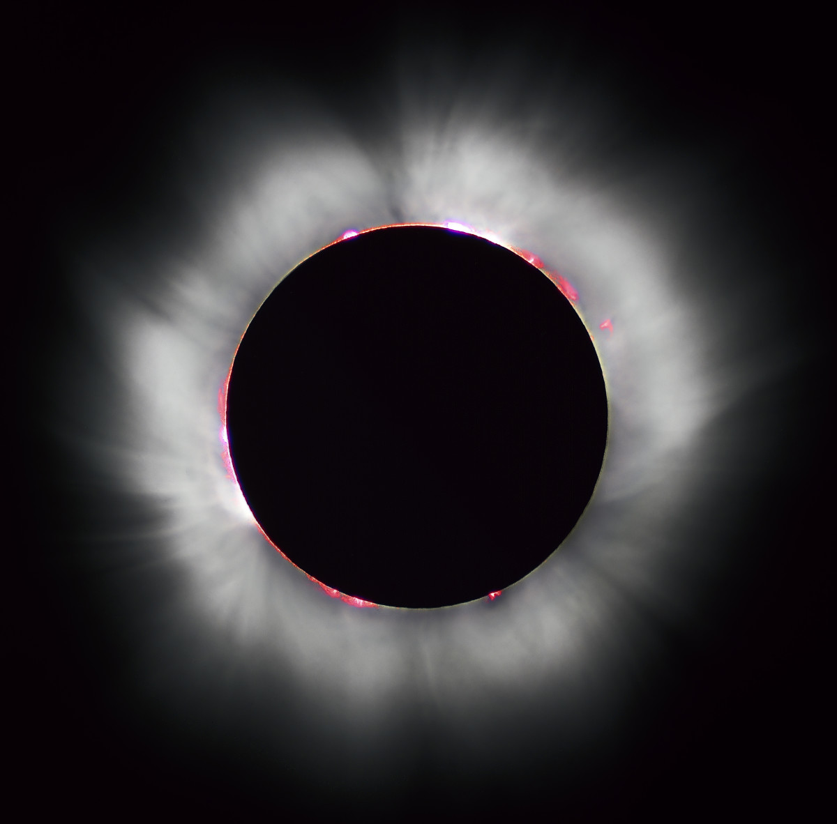 A total eclipse is surrounded by a corona of light, A corona is defined as the rarefied gaseous envelope of the sun.