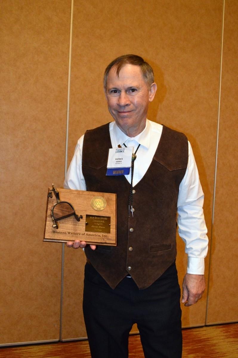 Patrick Dearen shown receiving Spur Award in Lubbock, Texas for 'The Big Drift.'