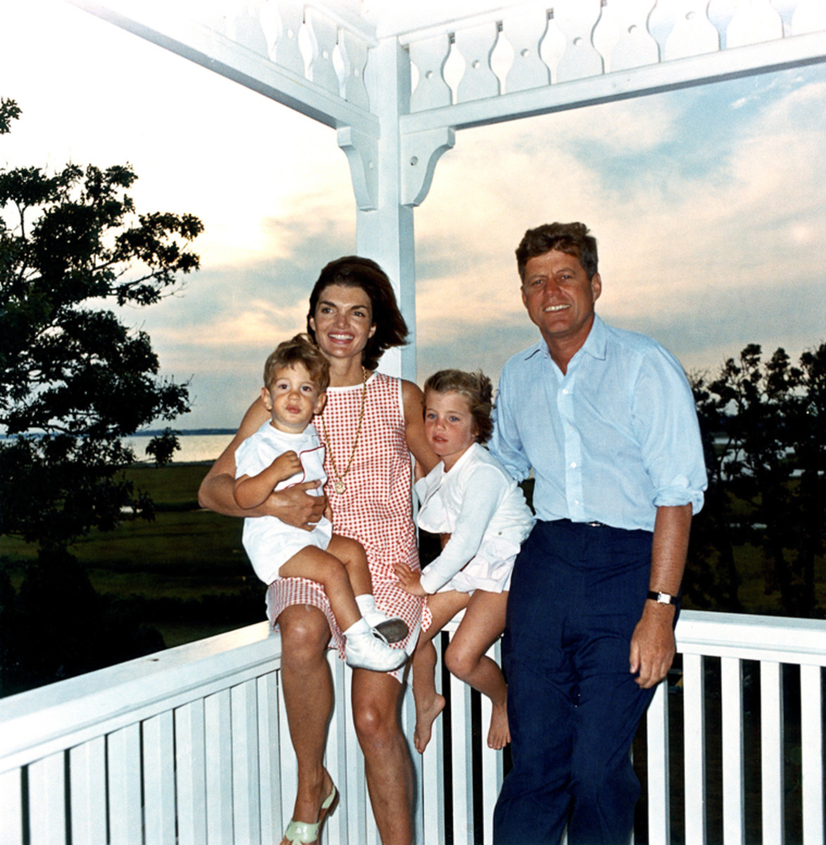 President John F. Kennedy, First Lady Jacqueline Kennedy, and their children John, Jr. and Caroline, at their summer house in Hyannis Port, Massachusetts. August 4, 1962