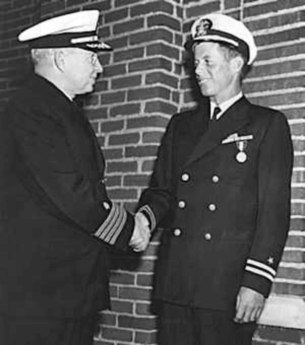 "Lieutenant. John F. Kennedy, USNR, is awarded the Navy and Marine Corps medal for ""...extremely heroic conduct as Commanding Officer of Motor Torpedo Boat 109..."". He rescued a crew of PT 109 during WWII on 8-2-43, when hit by a Japanese destroyer."
