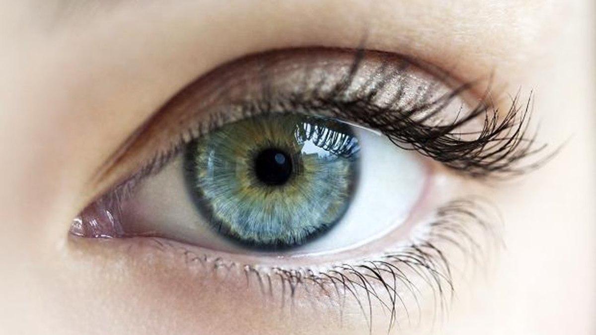 Blue green eye ball with long eye lashes