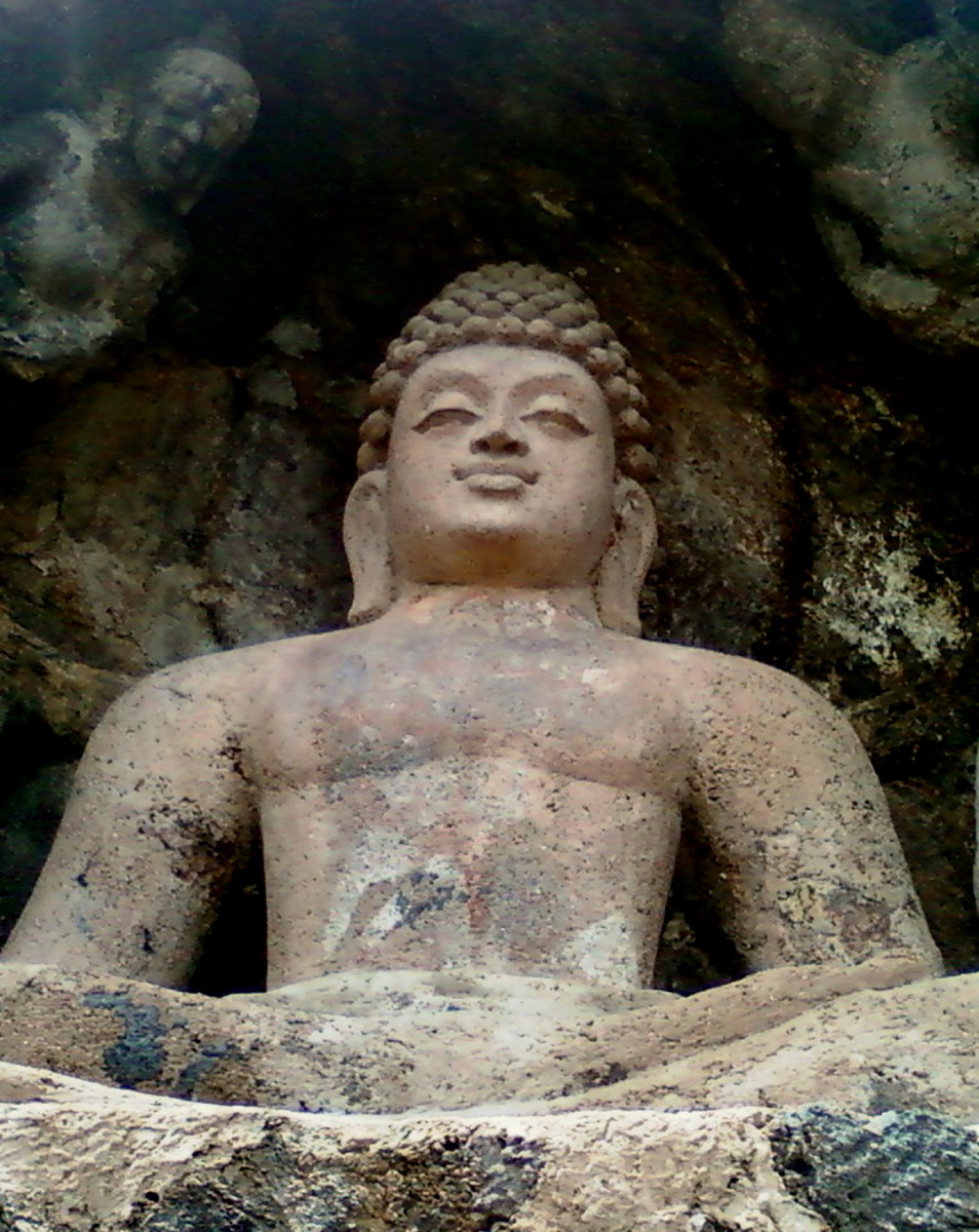 A Rock cut Seated Buddha Statue at Bojjannakonda, Visakhapatnam District by Adityamadhav83, 2011