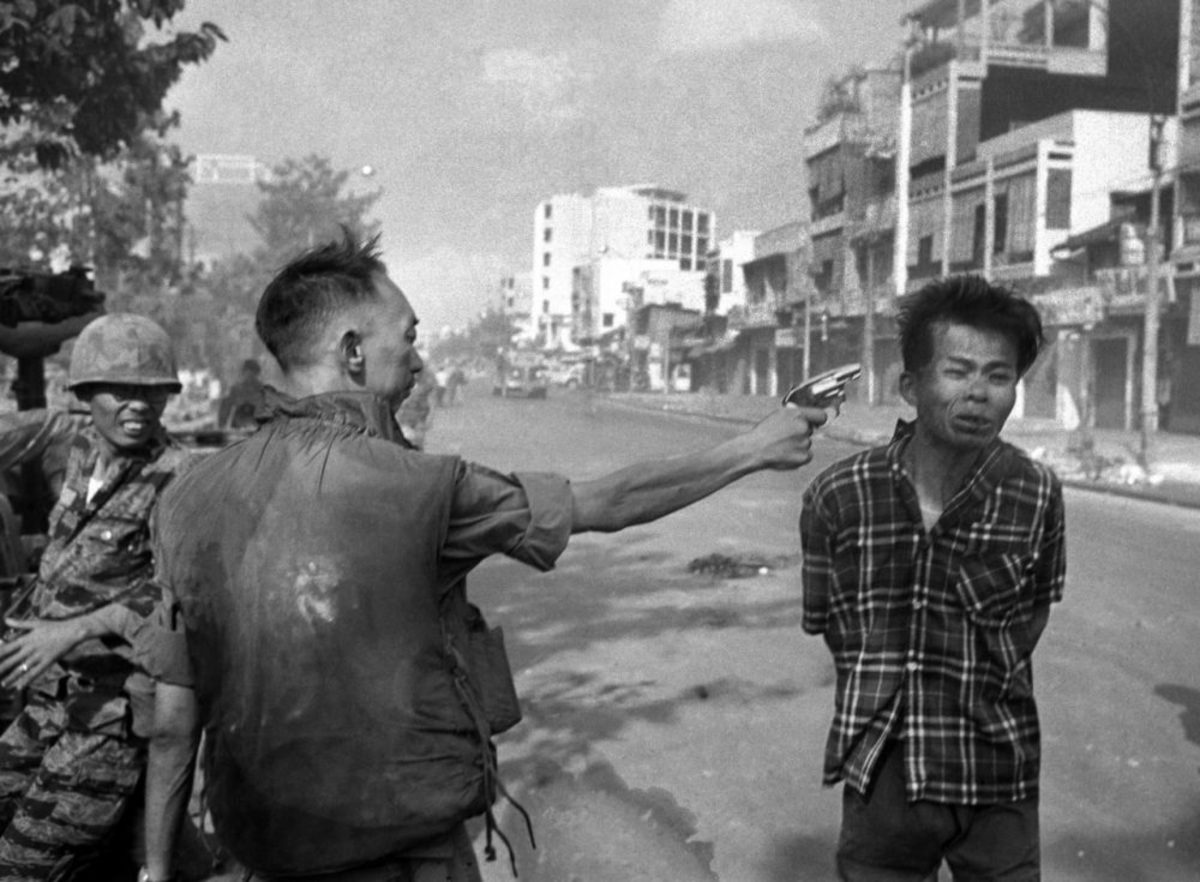 Gen. Nguyen Ngoc Loan, South Vietnamese chief of the national police, fires his pistol into the head of suspected Viet Cong official Nguyen Van Lem on a Saigon street early in the Tet Offensive, February 1, 1968.
