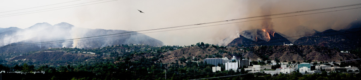 View of JPL with the 2009 California wildfires behind and the efforts to extinguish the blaze.