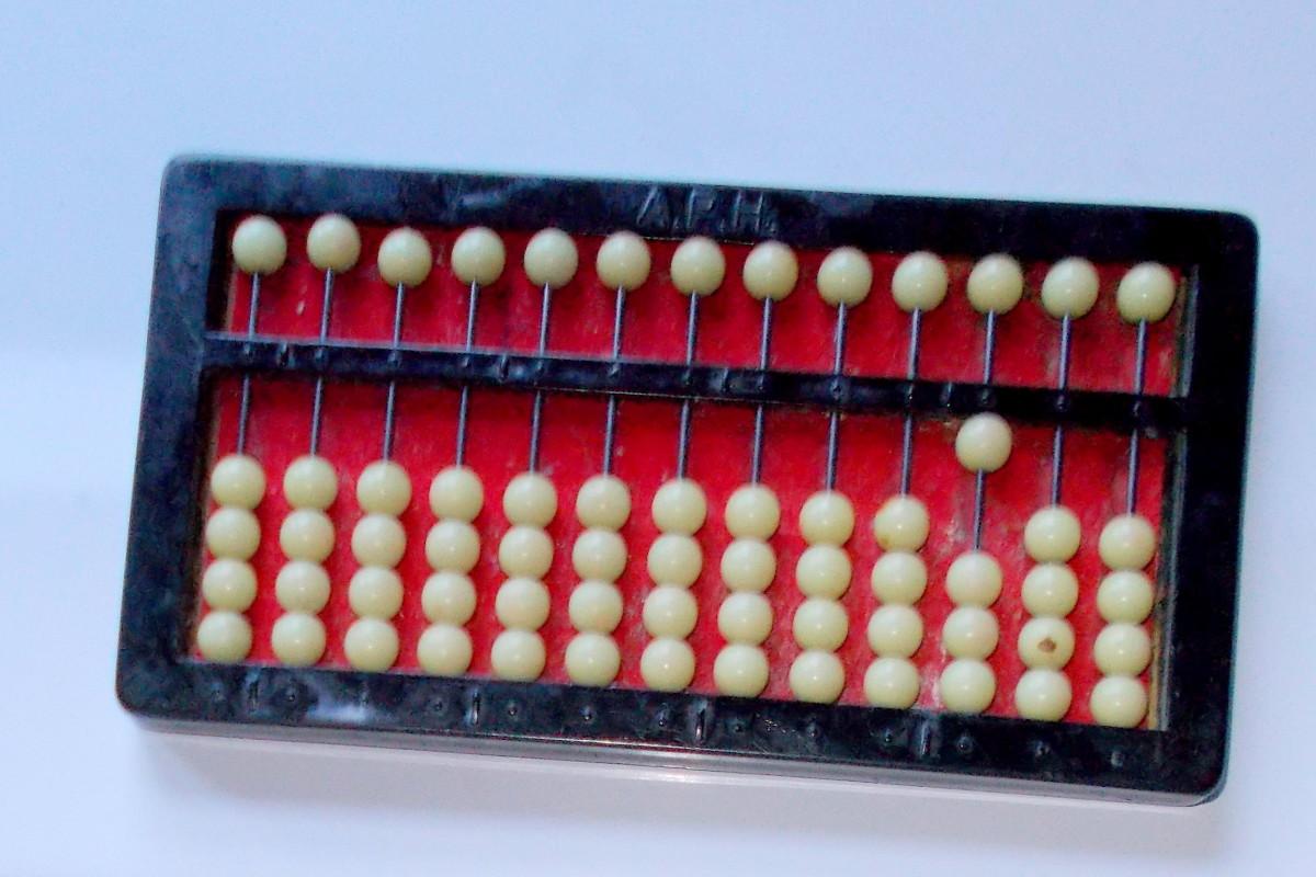 An abacus set at 100