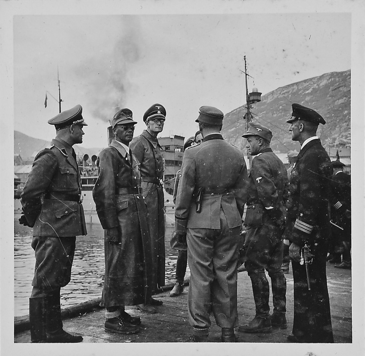 The pride of the Third Reich endures a bit of inclement weather in the Hammerfest harbour. Second from left is Josef Terboven head of the German occupation. When Germany surrendered he blew himself up.