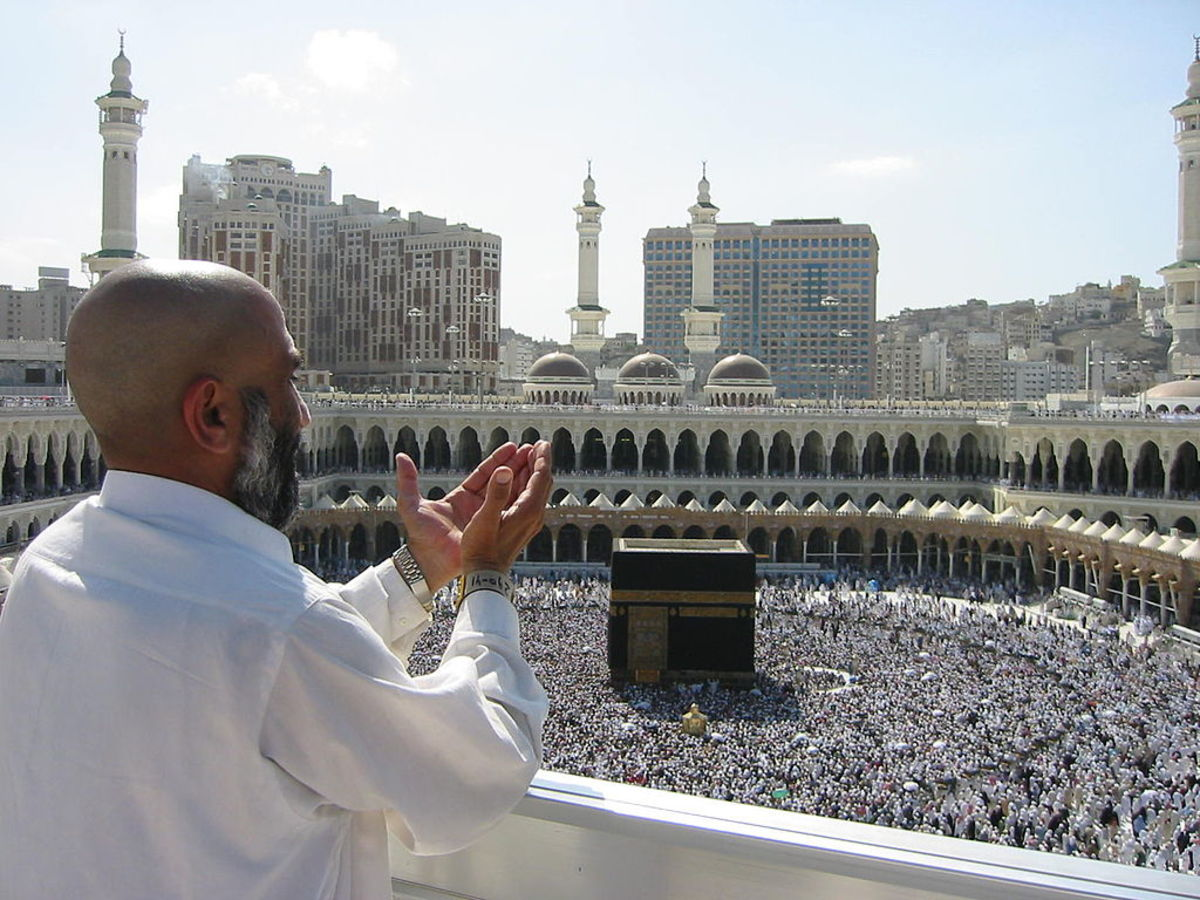 Supplicating pilgrim in Mecca, Saudi Arabia.
