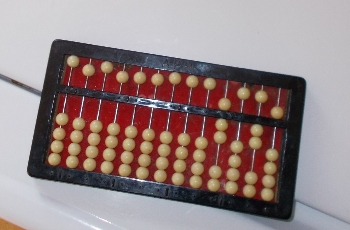 Remainders will appear after the quotient is found in the columns on the right hand side of the abacus. This abacus shows the quotient 7 with a remainder of 25.