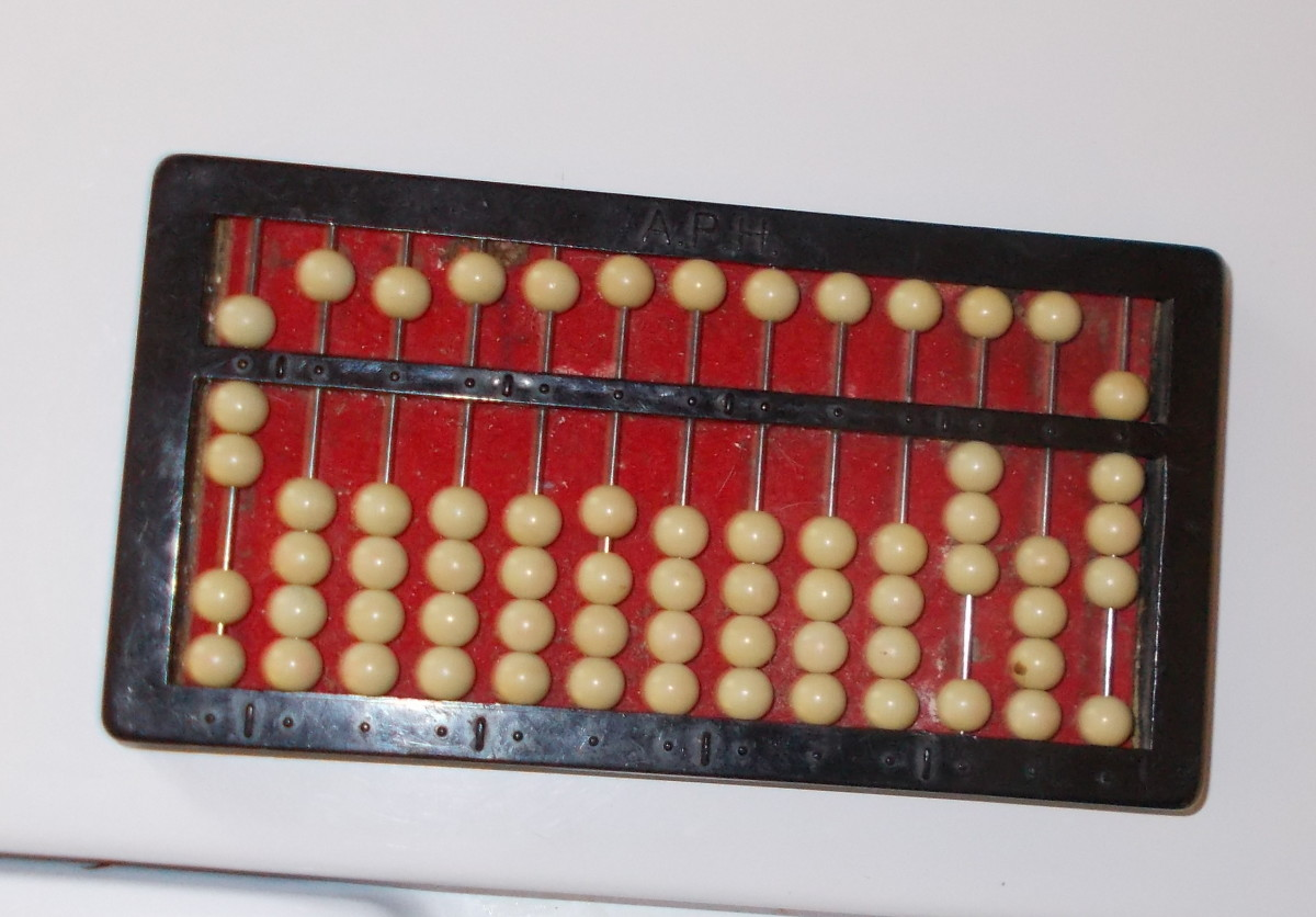 Division problems are placed on the abacus in a different way. The abacus in this photo reads: 308 divided by 7.
